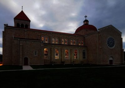 Dusk highlights the dramatic presence of the new (48) traditionally-styled stained glass windows - Photo: LOF Productions