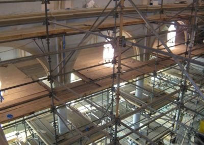 Floor-to-ceiling scaffolding allows access to the entire interior