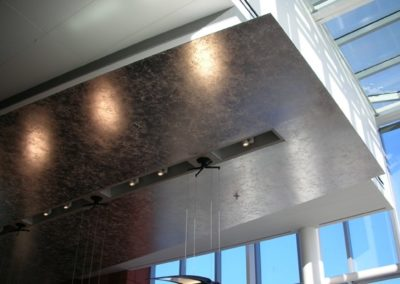 Composition aluminum leaf applied to ceiling panels for the Ross School of Business, Ann Arbor, MI