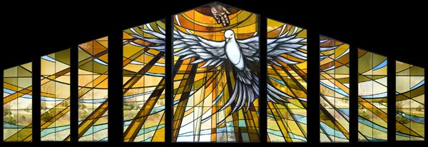 A new stained glass window above the entrance greets worshippers at St John the Baptist, Costa Mesa, CA