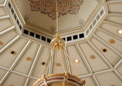 The finished ornamental light fixture and the stencil work compliment each other - Photo courtesy of Indiana Landmarks