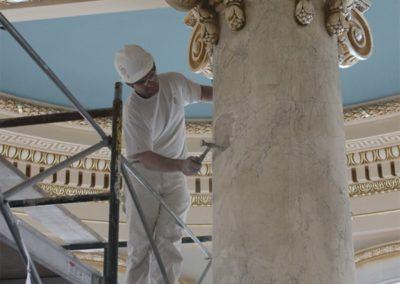 A CSS artisan repairs a scagliola column