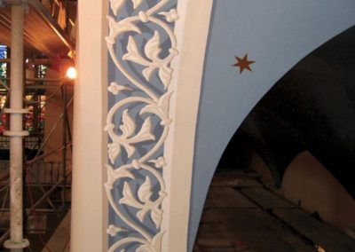 Trompe l'oeil painted arches at Holy Family Catholic Church