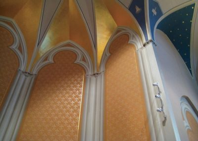 Trompe l'oeil painted sanctuary walls give the illusion of dimensional columns and tracery at Holy ...