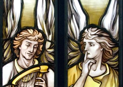 The Angel on the left signifies music while holding a harp, while the other portrays a gesture ofsilence with the finger on the lips.