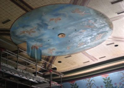 A shot of the old cherub mural on the ceiling
