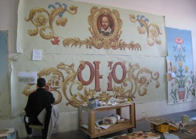 The Shakespeare mural and Grand Opera House insignia mural in progress