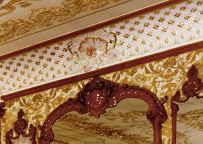 A closeup of the detail of the decorative painting, stencils and gilding