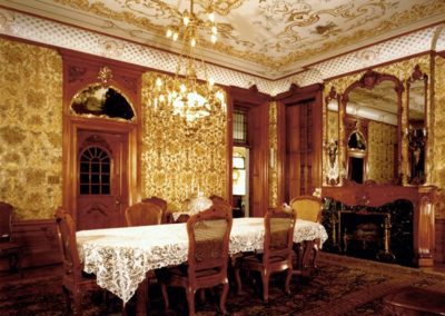 Elaborate stencil work and gilding bring elegance to this Pabst Mansion room