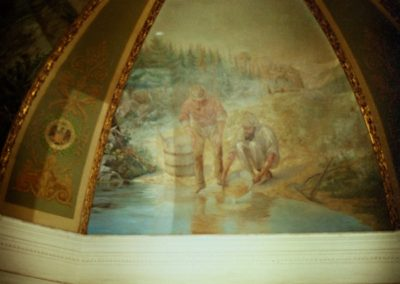 Cleaned areas of the mural are shown here during the mural conservation