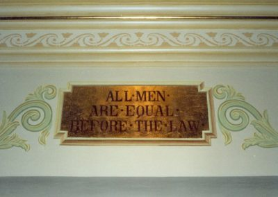 The restored plaque and hand-painted ornate decorative design