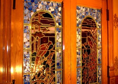 COMPLETED RESTORATION: Conserved interior stained glass doors