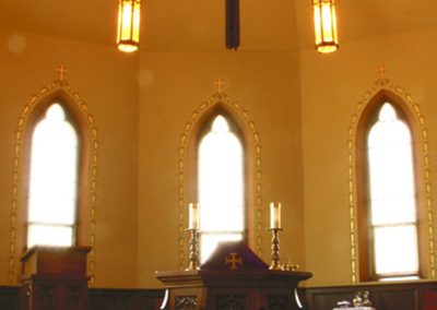 Chapel with gilded design elements surrounding the windows - photo: Edward Haydin AIA