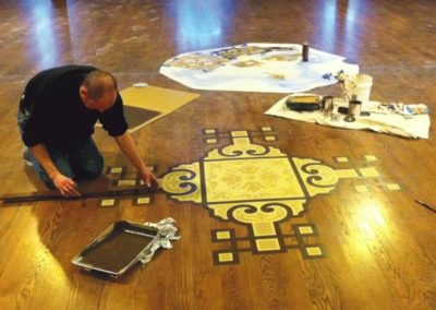 A CSS artisan creates a new design element on the floor - photo: Edward Haydin ...