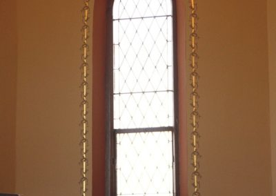 Close-up of the gilded design elements surrounding the windows - photo: Edward Haydin AIA