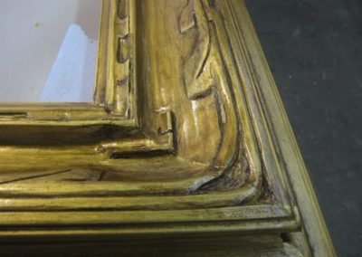 A transparent medium is added over gilded surface