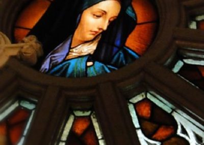 Mary graces the center of the rose window
