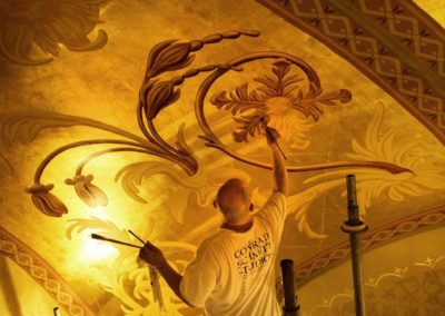 A CSS artisan works on the ceiling. Photo: Eyd Kazery