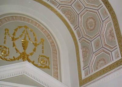 Restored arch with its elaborate stencils and elegant gilding and glazing