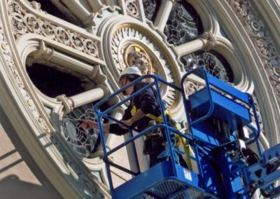 A CSS artisan removes window panels from the rose window