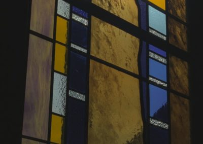 Detail of new contemporary stained glass shows a variety of colored glass