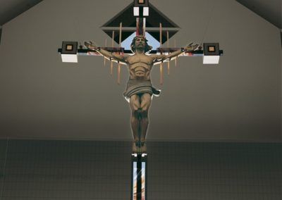 New crucifix features jelutong wood, gray steel, copper pipe and copper leaf, as well as German opalescent glass.