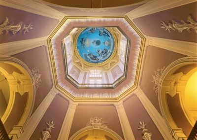 Trompe l'oeil painting and stencils add depth to the dome decorative painting