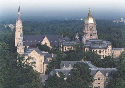 The campus of the University of Notre Dame shows the gilded dome and Our Lady