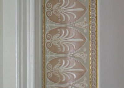 Section of wall with gilding and glazing