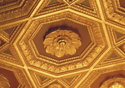 A detail of one of the gilded ceiling rosettes