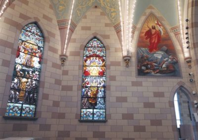 The sacristy restored to its pre-fire decorative scheme with replicated windows and new mural