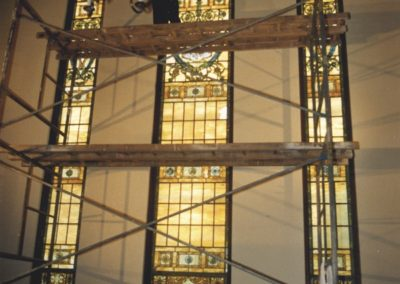 Scaffolding is assembled to obtain access to the windows for safe removal