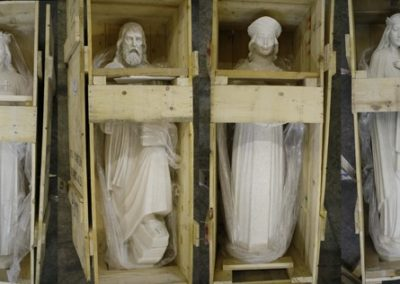 All four statues in their crates after shipment and inspection
