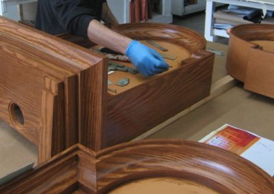 An artisan applies the wood grain by hand to each surface