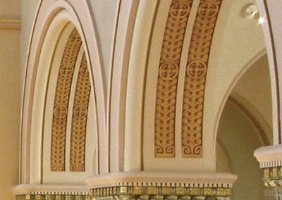Detail of the restored capitals and stenciled arches - Photo: Bill Sheets