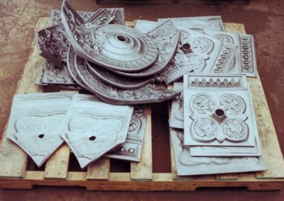 Pieces of the forged cast iron elements for the set of light fixtures