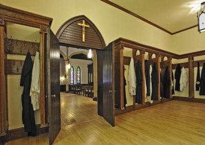 Elegant new woodwork in the Vesting Room complements the new stained glass