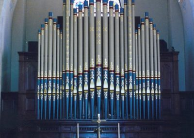 The organ pipes were painted to match the historically inspired decorative scheme