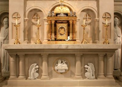 New bas relief carved stone statues adorn the altar for St. Louis Church - Photo by: Looney Ricks Kiss