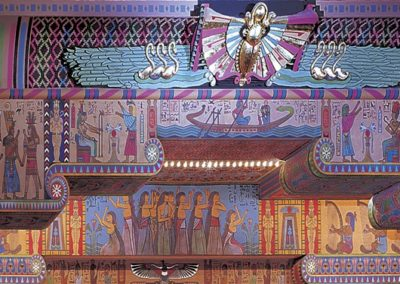 Detail shows extensive decorative painting of Egyptian motifs