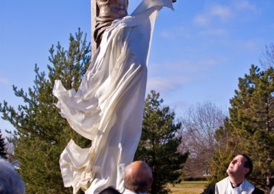 The new crucifix is unveiled to the congregation in a dedication ceremony