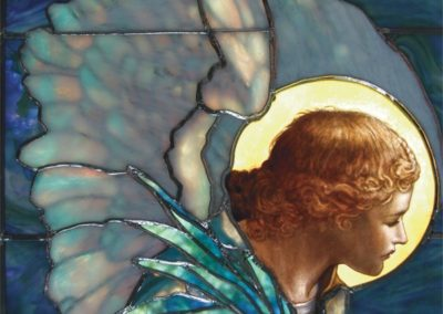 A detail of an angel highlights the beauty of the opalescent glass
