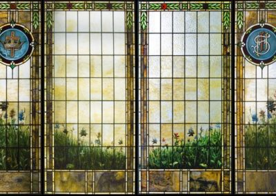 New center window panels were created to match with existing stained glass