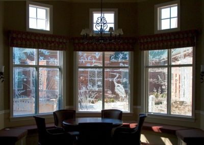 Etched glass adds intrigue in the lounge area with nature and wildlife scenes