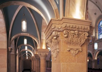 The side aisle arches, painted hoods and gilded capital at Holy Hill