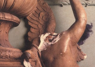 A damaged statue before the restoration