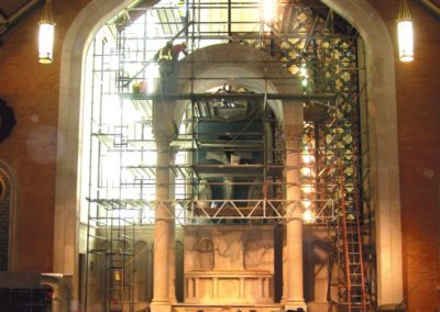 New stained glass is installed in the Sanctuary
