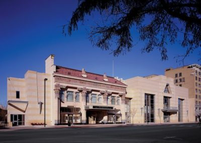 Exterior view of restored theater and compatibly designed conference center and elevator tower
