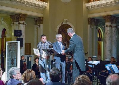 kevin grabowksi conrad schmitt receiving award south dakota capitol dome renovation